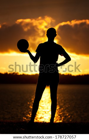 Teen Volleyball Girl Poses Silhouette Lake Background