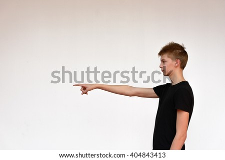 Teenage boy pointing finger