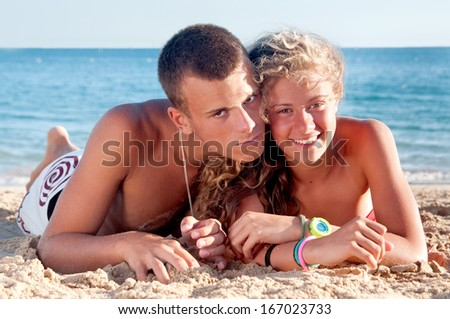 teenage girl and boy posing in the beach