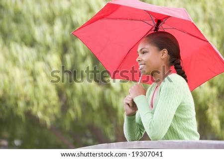Teenage Girl Under An Umbrella Outside