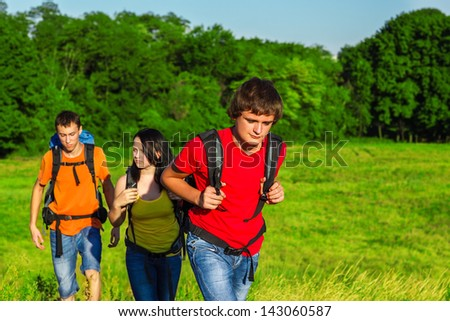 Teenage students enjoying summer vacations with backpacks
