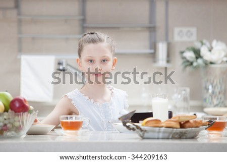 teenager at breakfast in the kitchen
