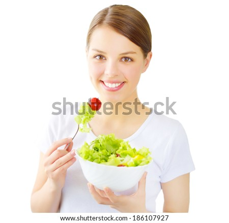 Teenager girl eating salad isolated on white background