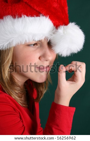 Teenager in red shirt and fluffy christmas hat