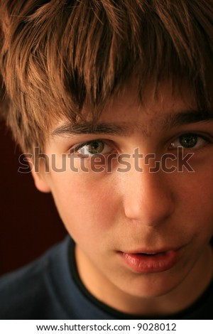 teenager looking into the camera and talking