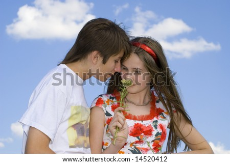 Teenagers are tasting the beautiful flower.