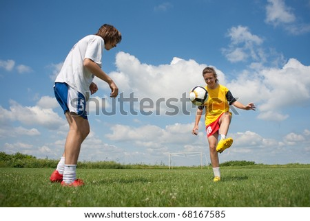 teenagers playing soccer