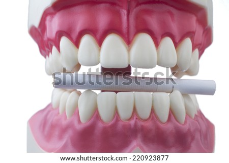 Teeth and a cigarette with white background