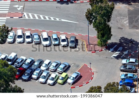 TEL-AVIV, ISRAEL - MAY 22 : Aerial view of full cars city parking on May 22, 2014 in Tel Aviv, Israel. The government has promoted park and ride to reduce traffic congestion