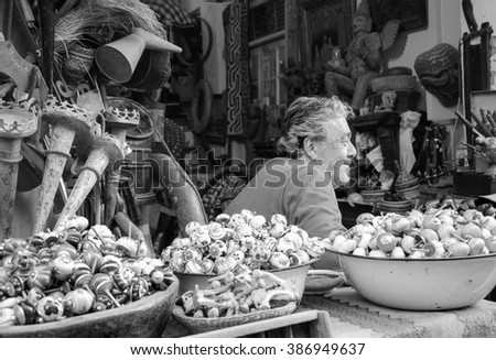 TEL AVIV-YAFO, ISRAEL - FEBRUARY 18, 2014: Unidentified vendor of secondhand store waiting for the clients. Jaffa flea market is popular attractions for tourists and locals.