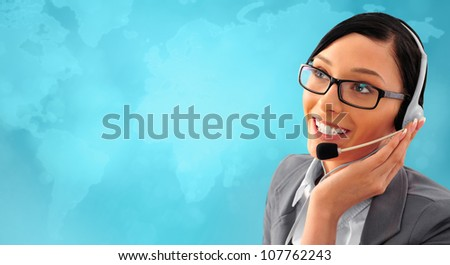 Telemarketing headset woman from call center smiling happy talking in hands free headset device. Business woman in suit in front of world map background.