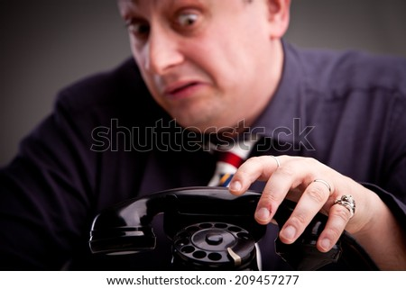 Telephone rings and the clerk is afraid of taking the call