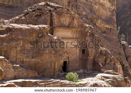 Temple or tomb facade hewn in the sandstone at Petra, Central Jordan. This archaeological site, former capital of the Nabateans, is a Unesco World Heritage Site.