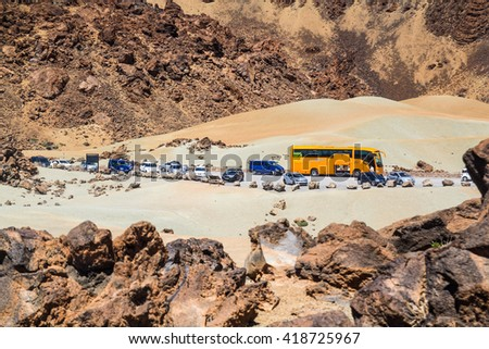 TENERIFE, SPAIN - APRIL 17, 2016: The tourist buses and cars in the Teide national park
