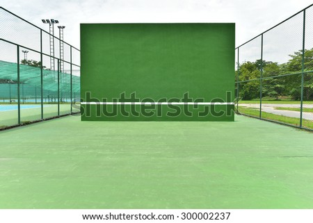 Tennis knock board green color with white line.