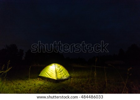 Tent at night in the field. Starry night.