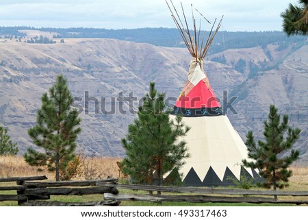 Tepee Behind a Split-Rail Fence Overlooking a Canyon in Oregon