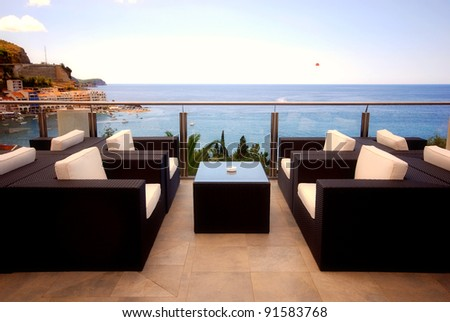 Terrace lounge with rattan armchairs and seaview in a for Terrace parent lounge