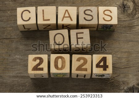 Text Class of 2024 on a wooden background
