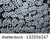 Texture of the end of aluminum rod for armor rod electrical cable - stock photo