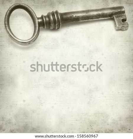 textured old paper background with old rusty  key