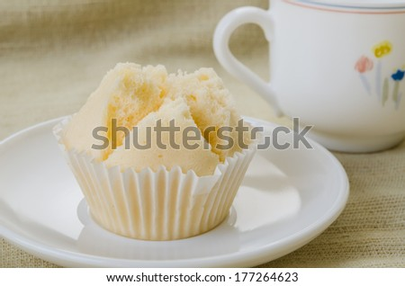Thai cup cake in white plate on brown fabric