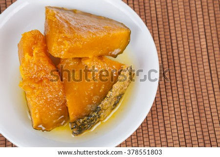 Thai dessert ,Pumpkin in syrup on white dish