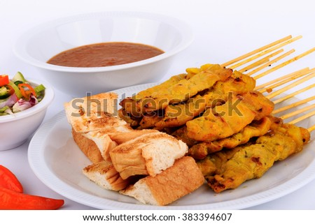 Thai food, Grilled pork satay with peanut sauce and toast.Traditional Thai style, Grilled pork satay with peanut sauce and toast.