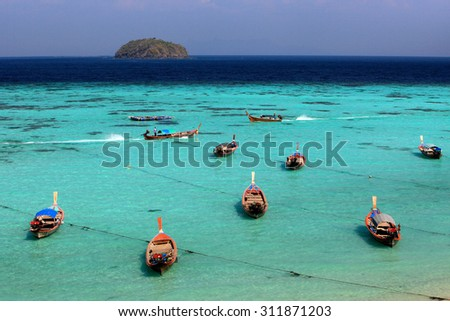 Thai local fishing boats on seaside at Lipe island beach of the Andaman sea, in Satun Province of Thailand.