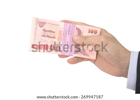 Thai Male hand handling pack of 100 banknotes of 100 baht isolated on white