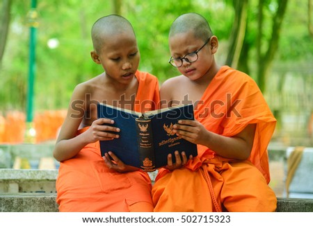 Thailand, April 1, 2016: Reading novice monks. Buddhist temple in Thailand
