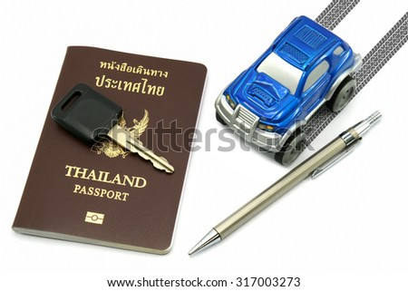 Thailand passport, key, pen and blue 4wd car for travel concept.