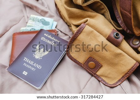 Thailand passport & wallet with vintage bag on the bed / Need go to freedom (close up)