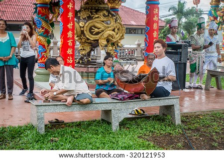 Thailand 2015 Sep 24. Musician playing Thai classical music for crown who Asking for fullfill their need with City Pillar's spirits.Chantaburi ,Thailand.