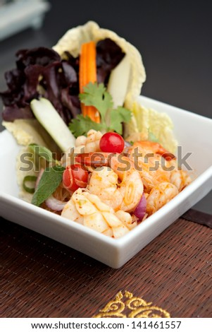 Thailand style seafood salad with clear vermicelli style rice noodles and veggies.