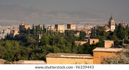 The Alhambra seen from behind looking out to Granada. This is an unusal viewpoint taken from a point about 5-10 minutes walk through an olive grove behind the Alhambra