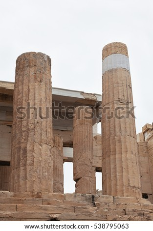 The ancient destroyed building with columns of marble.