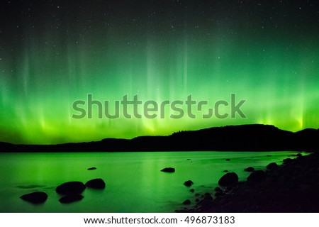 The aurora look like heavenly flames over Lake Superior.
