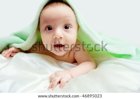 The baby under a blanket