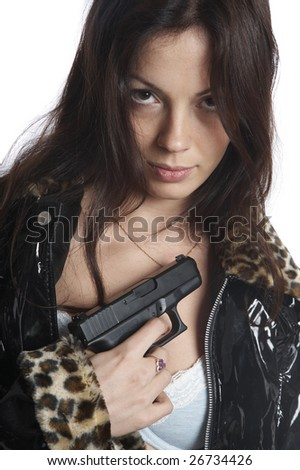 The beautiful girl with a pistol on a white background