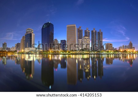 The beautiful landscape of lake and business building on night Bangkok cityscape capital of Thailand