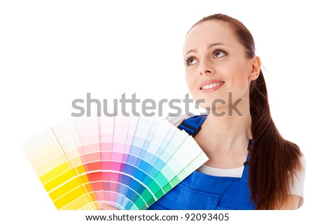 The beautiful young woman with a color guide on a white background. Designer of interior.