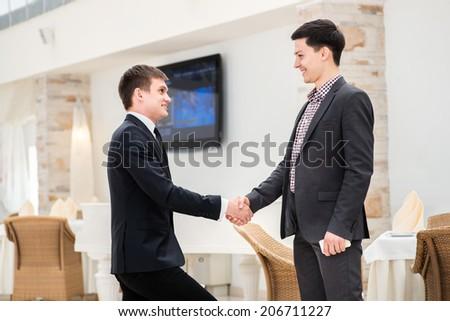 The best day for business transactions. Two successful and confident businessman standing in office and shake hands.
