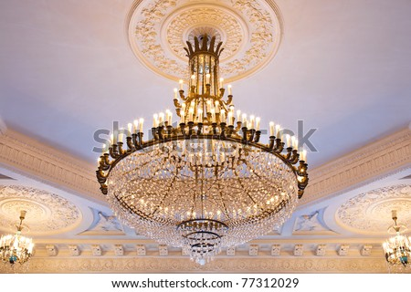 The big crystal chandelier in an ancient palace