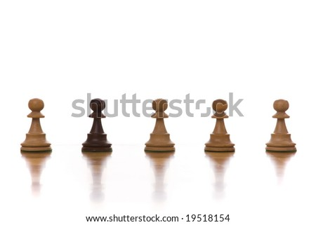 the black chess pawn next to multiple white chess pawn (selective focus)