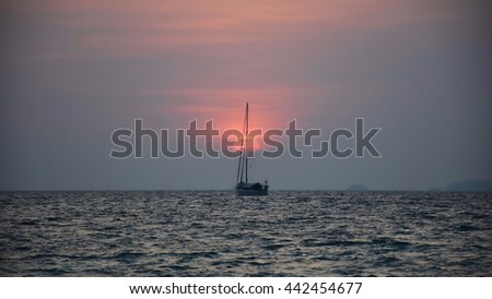 The boat in the sea on sunset