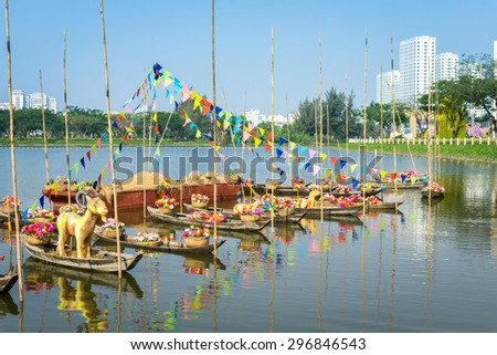 The boats in harbor of city/Boats in city harbor. HDR image/Ho Chi Minh, Vietnam â?? Feb 13th 2015: This image shot on Ban Nguyet riverbank, cityscape of Phu My Hung, at Tet holiday 2015