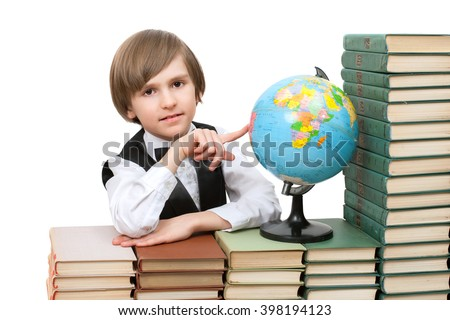 the boy chooses the place of study on the globe