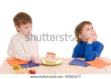The boy gives a piece of cake to another boy