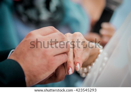 The bride and groom exchange rings, wedding ceremony, hands closeup